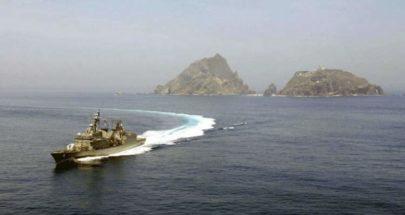 اصطدام مدمرة يابانية بقارب صيد صيني image