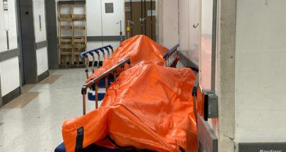 """صور قاسية... أكياس جثامين وفيات """"كورونا"""" في ممرات المستشفيات! image"""