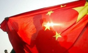 الصين تدعو مواطنيها في كندا لتوخي الحذر وسط السجال بشأن هونغ كونغ image