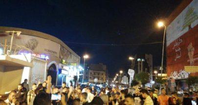 وقفة تضامنية لمحتجين في طرابلس مع محتجي بيروت image