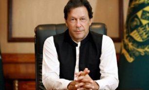 رئيس وزراء باكستان يدافع عن رفع العزل العام image