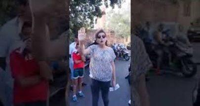 """تجمع أمام مركز الحجر في الكرنتينا تتوسطه يعقوبيان : """"استعدوا للاعتراض"""" image"""