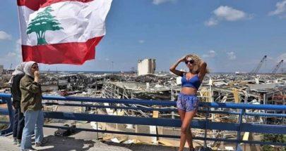 فتاة بملابس مكشوفة تخضع لجلسة تصوير على أنقاض بيروت! image