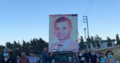 مسيرة صلاة وشموع في بلدة عانا لراحة نفس الشهيد كيوان image