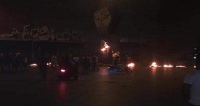 إحراق قبضة الثورة مساء أمس في ساحة النور في طرابلس image