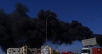 دخان أسود كثيف يتصاعد من معمل الجية image