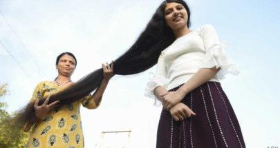 بعد قصه أمام الكاميرات.. صاحبة أطول شعر في العالم تتبرع به لمتحف أميركي image