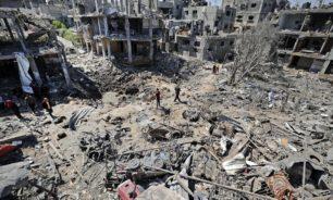 غارات وهدم منازل في غزة وصواريخ صوب إسرائيل image