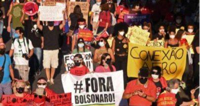عشرات آلاف البرازيليين يطالبون بعزل بولسونارو image
