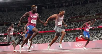 الكندي دي غراس يخطف ذهبية سباق 200 متر image