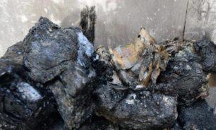 العثور على أكياس من الأوراق النقدية تحت أنقاض البنك المركزي في الموصل image