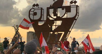 إضاءة شعلة 17 تشرين قرب مرفأ بيروت image